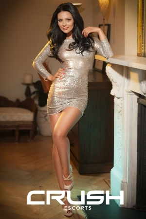 Chantal From Crush Escorts Wearing A Silver Dress