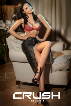 Chantal From Crush Escorts Wearing A Black Skirt And Red Bra