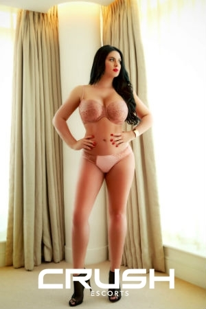 Pamela From Crush Escorts Wearing Pink Underwear and Black Heels