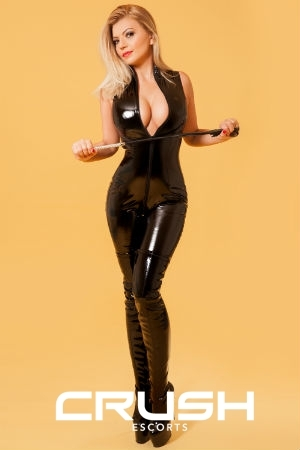 Mistress Raisa From Crush Wearing A Full Body Latex Outfit