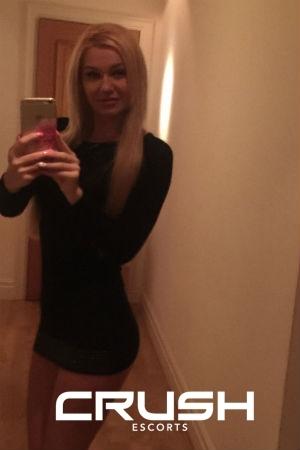 Melissa taking a selfie in the mirror.