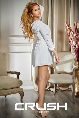 Rosana from Crush wearing a cute white dress.