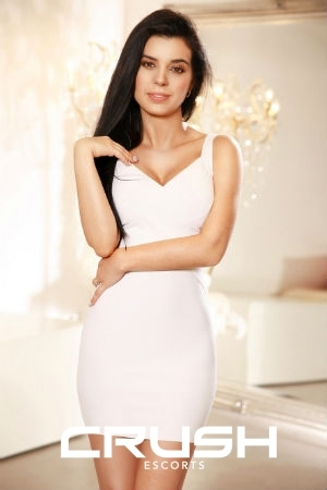 Paula From Crush Escorts Wearing A White Dress