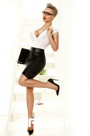 Galina in a secretary outfit and high heels.