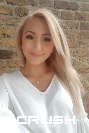 Briela wearing a white top.