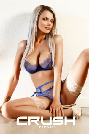 Geordie wearing blue lingerie and beige stockings.