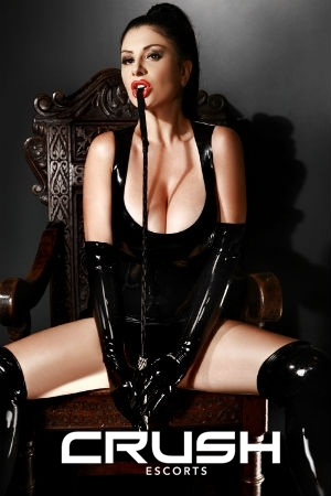 Emely is wearing a latex outfit.