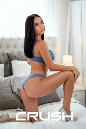 Kely is posing in blue lingerie.