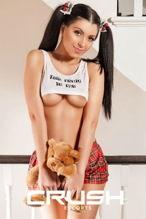 Evita is wearing a naughty school girl outfit. Find here within role play London escorts