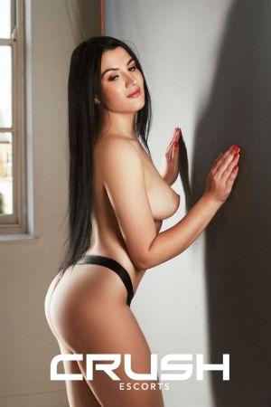 Helen is posing topless and wearing black underwear.