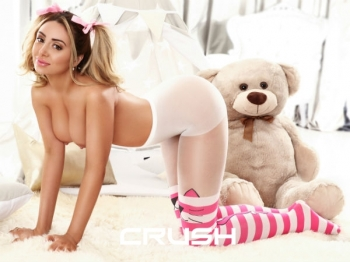 Leonna is posing topless and wearing pink and white tights.