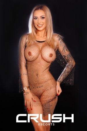 Sloane is posing sexy in a fishnet.