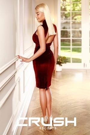 Raisa from Crush escorts is looking elegant in a red velvet dress.