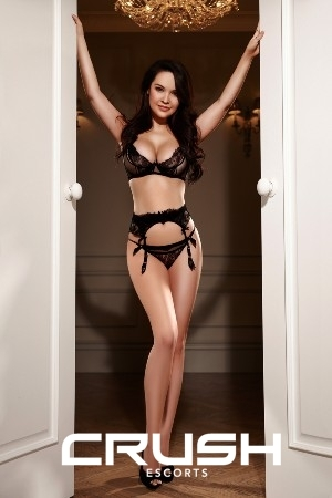 Karolina looking hot in black lace lingerie and high heels.